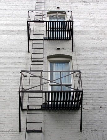 fire escape: Fire escape on a white brick building