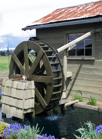 old grist mill: Decorative wooden water wheel