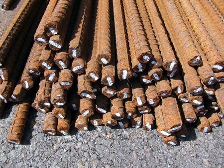 reinforce: Steel rods or bars used to reinforce concrete at construction site
