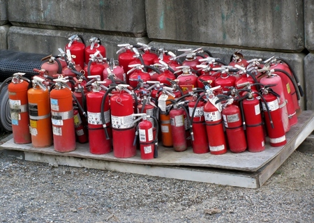smother: Old fire extinguishers Stock Photo