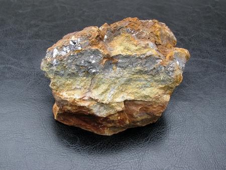 chatoyant: Sample rock on black background