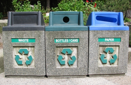 household waste: Three roadside bins for recycling household waste in an urban environment. Stock Photo