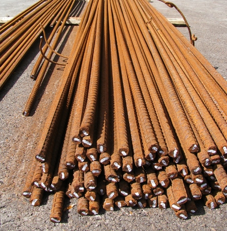 solver: Steel rods or bars used to reinforce concrete at construction site