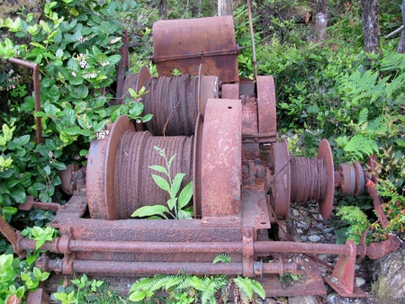 Old rusty abandoned wire winch in the forest Reklamní fotografie