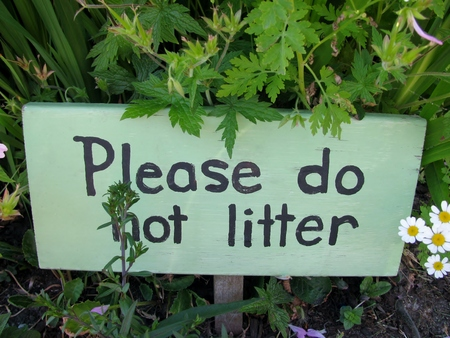 public waste: Please do not litter Sign in a garden