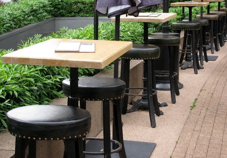 menue: Outdoor  restaurant tables and high stools