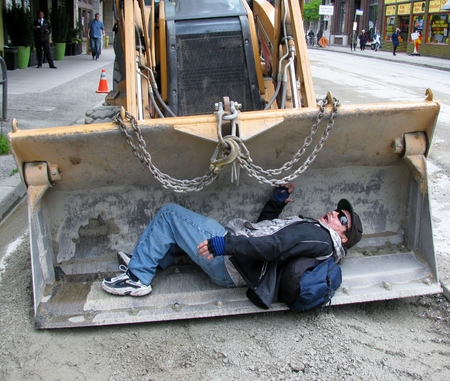 cries: Man lying in the bucket of an excavator screaming. Vancouver, Canada. Photo was taken: April 20, 2016