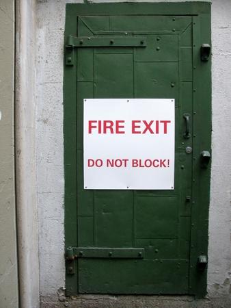 green door: Fire exit do not block! sign on a green door Stock Photo