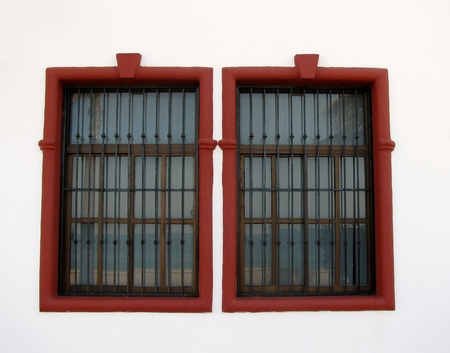 windows frame: Red frame windows in a white wall Stock Photo
