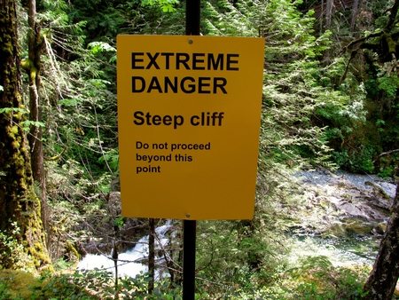 extreme danger: Extreme Danger steep cliff sign. Vancouver Island, Canada