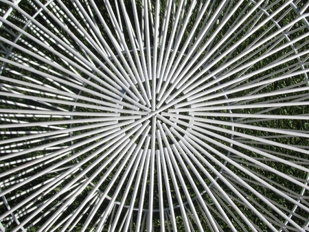 round rods: Abstract design, patio table on the green grass.