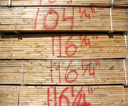 jointed: Dimension lumber sizes  written on new finger jointed lumber in stacks Stock Photo