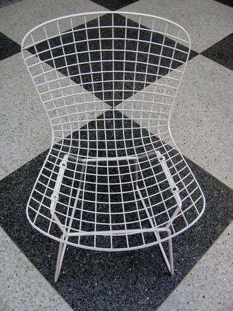 Retro chair black and white checkered floor pattern Stock Photo