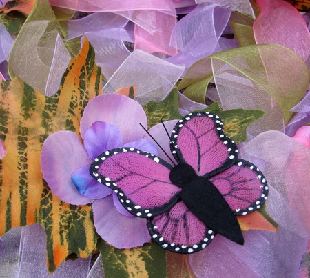 Handmade pink butterfly on colorful background Stock Photo - 67670785