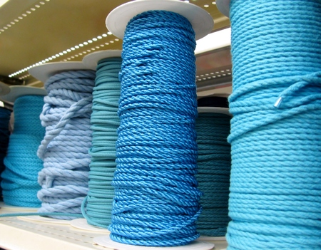 Various blue ropes on coils.