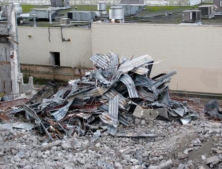 Demolition of building in urban environments. 版權商用圖片
