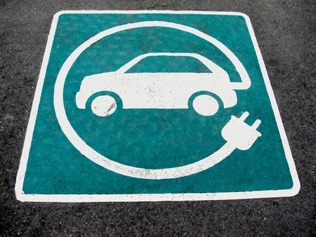 echnology: Eco electric car sign on asphalt