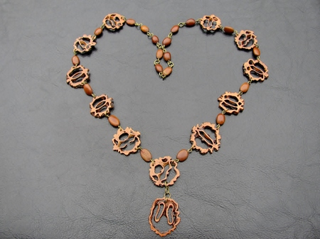 Necklace made from acacia seeds and sliced walnut shells