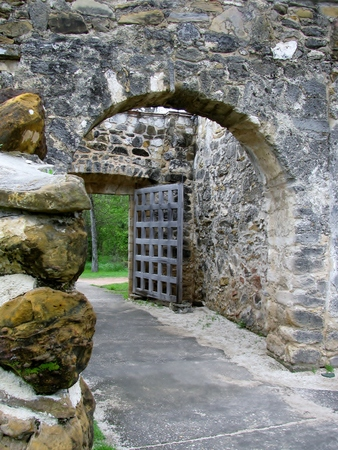 Old arch wooden gate. Entrance to the park.