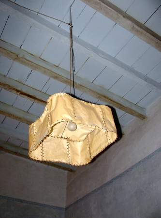 lamp shade: Parchment lantern hanging from the ceiling