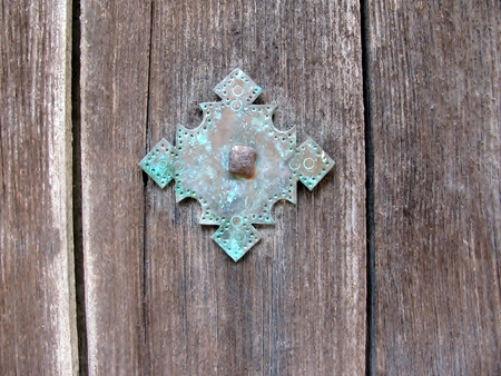 Metal square ornament on an old wooden door Stock Photo