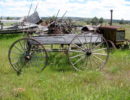 ploughing: Old wooden cart and rusty tractor