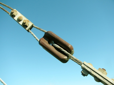 Link of the cable pulled against blue sky.