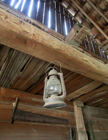 Dusty lantern hanging in an old barn