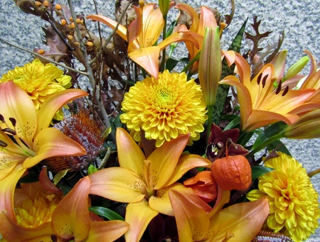 Beautiful orange lilies and chrysanthemum flowers in autumn bouquet Stock Photo