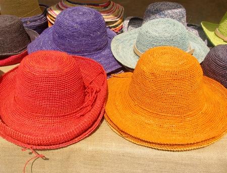 Purple, grey, red and orange straw hats