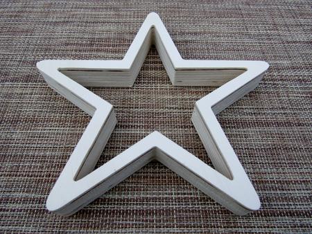 White comprised wood star decoration Фото со стока