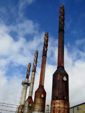 Chimneys with antivortic spiral of Port Allen Power Plant on Kauai, Hawaii, USA Imagens
