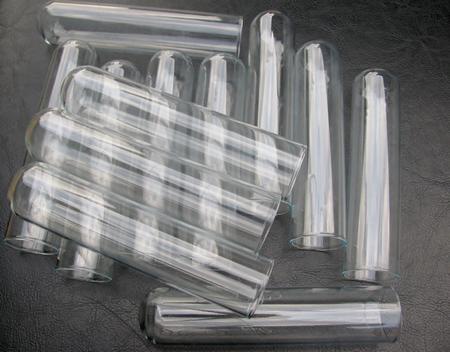 Laboratory beakers and glassware on black background Imagens