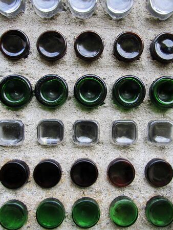 Wall made of glass bottles background