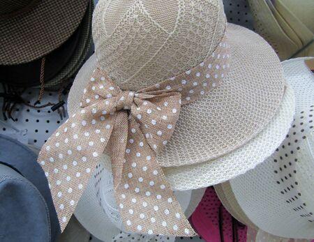 Polka dot wide bow on beige sunhat Imagens