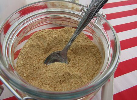 Brown sugar with spoon in glass jar for DIY cupcake decoration station