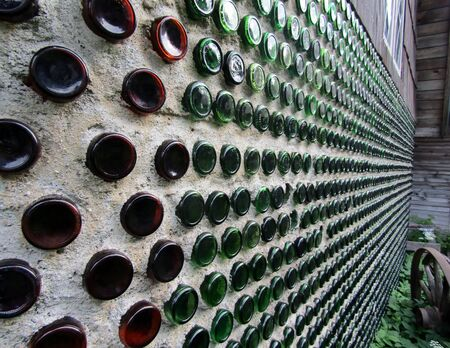 House wall made of glass bottles Stock fotó