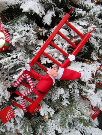 Vintage Elf on red ladder toy hanging on Christmas tree