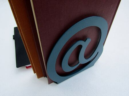 Books and decorative metal ampersand & sign bookend