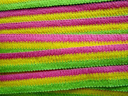 Pink, green and yellow decorative trim background