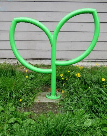 Green metal leaf-shaped bike rack