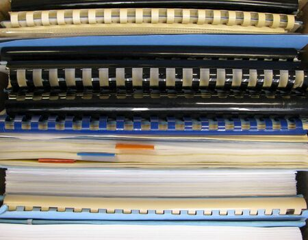 Stack of notebooks with comb binding