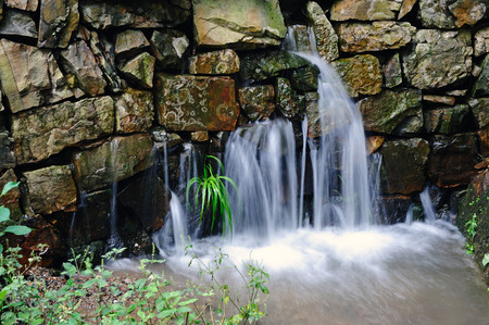 filamentous: Bluegrass and small waterfall slow shutter exposure