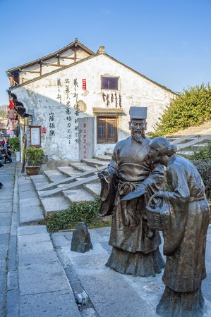 deeds: Sculptures in the street of old town at Shaoxing