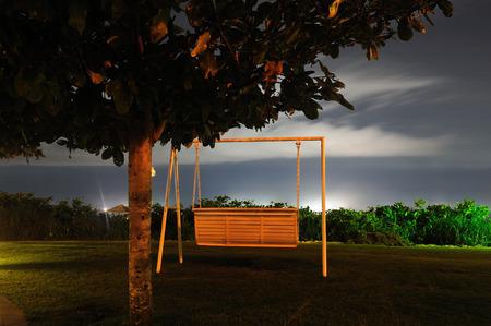 convective: Yalong Bay Beach rocking chair Stock Photo