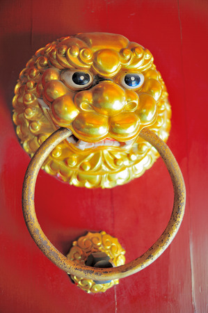 ancient lion: Ancient knocker with lion head Stock Photo