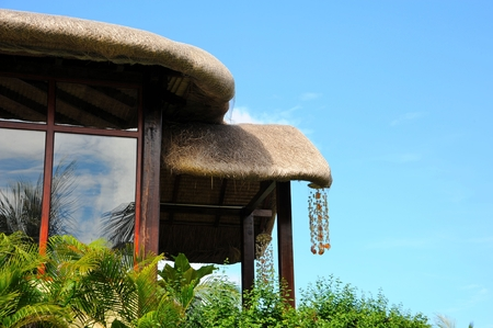 wind chimes: Tropical thatched roof and under the blue sky wind chimes
