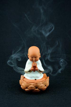 Incense: Little monk lighting incense censer of incense