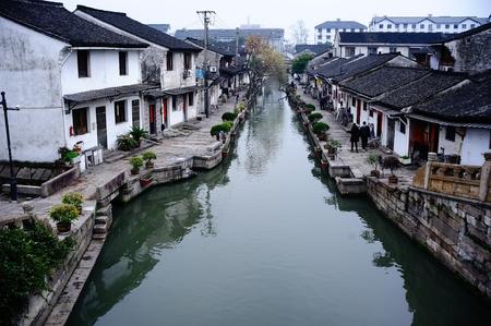 humanities: Zhejiang Shaoxing, Bazi bridge community houses along the river. panorama view