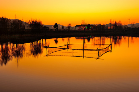 warm water fish: Sunset fish ponds and cages